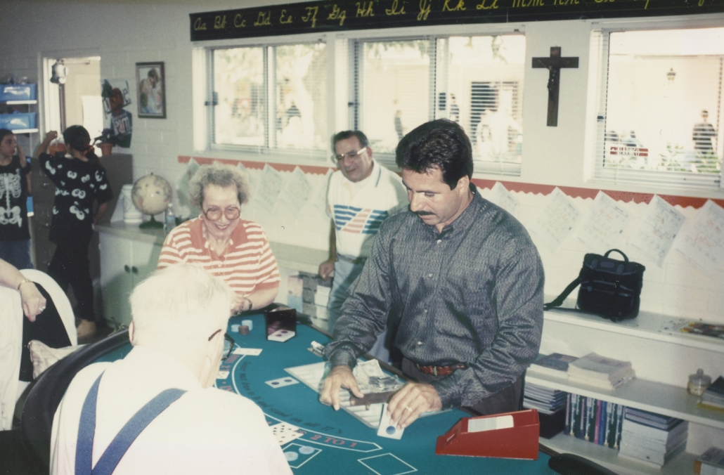 1990 Ron deals blackjack at charity event with his Mom playing and Dad watching