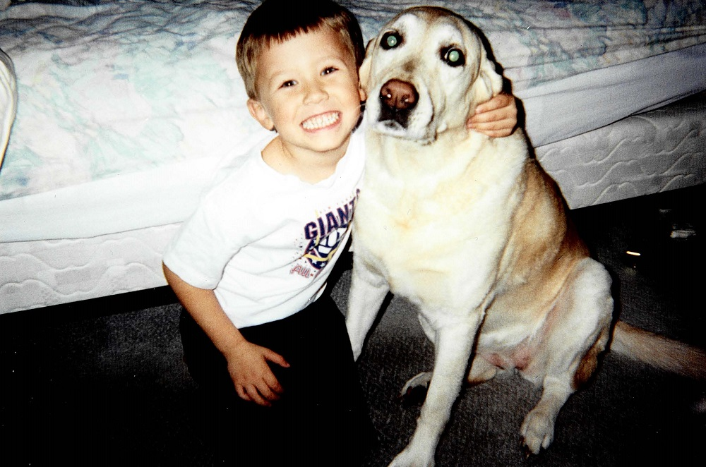 2000 Tommy with family dog, Sandy